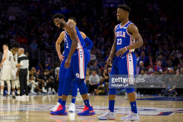 Ben Simmons Joel Embiid and Jimmy Butler of the Philadelphia 76ers react against the Brooklyn Nets in Game Two of Round One of the 2019 NBA Playoffs...