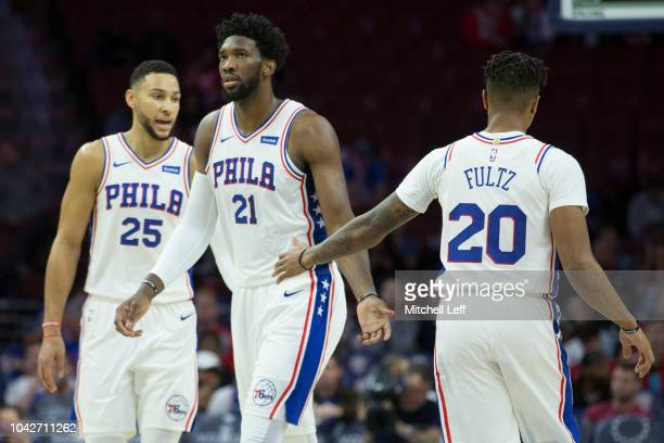 Ben Simmons Joel Embiid and Markelle Fultz of the Philadelphia 76ers celebrate against Melbourne United in the first quarter in the preseason game at...