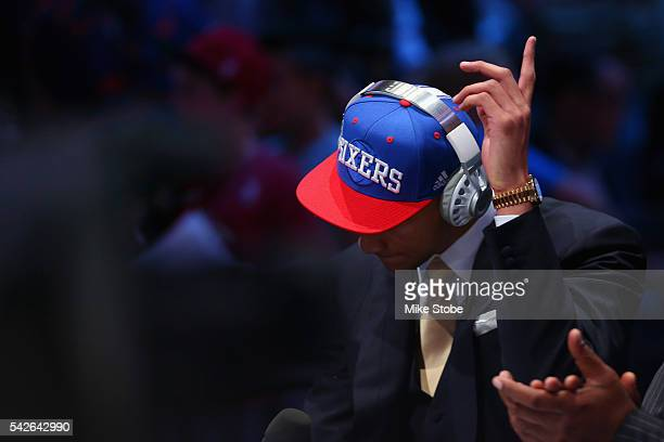 Ben Simmons motions after cheers from the crowed during his interview after being drafted first overall by the Philadelphia 76ers in the first round...