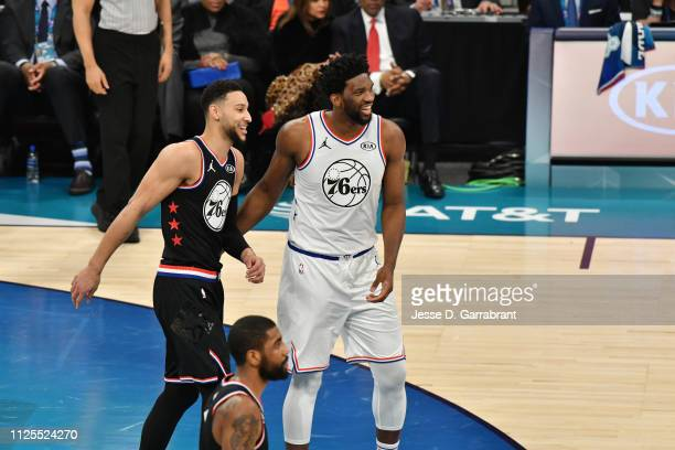 Ben Simmons of Team LeBron and Joel Embiid of Team Giannis look on during the 2019 NBA All Star Game on February 17 2019 at Spectrum Center in...