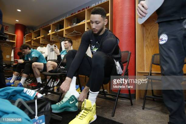 Ben Simmons of Team World puts his sneakers on during the 2019 NBA AllStar Rising Stars Practice and Media Availability on February 15 2019 at...