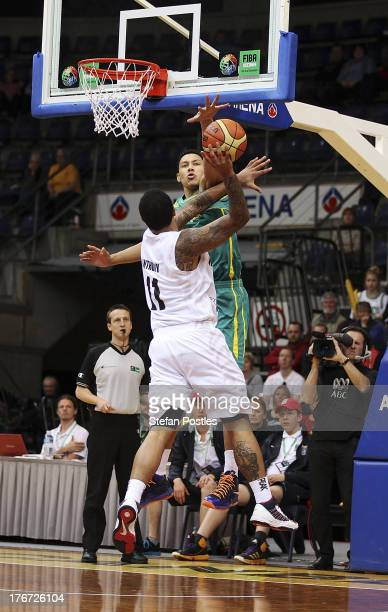 Ben Simmons of the Boomers denies BJ Anthony a shot during the Men's FIBA Oceania Championship match between the Australian Boomers and the New...