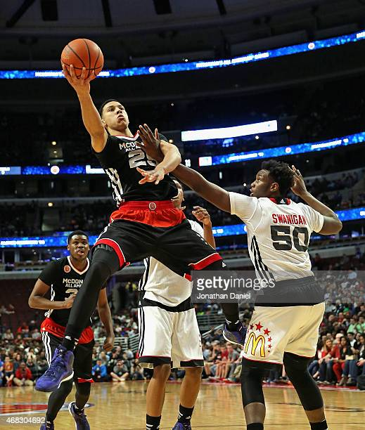 Ben Simmons of the East team puts up a shot over Caleb Swanigan of the West team during the 2015 McDonalds's All American Game at the United Center...