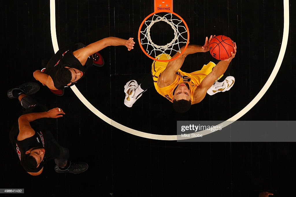 Ben Simmons #25 of the LSU Tigers drives to the basket against the North Carolina State Wolfpack at Barclays Center on November 24, 2015 in Brooklyn borough of New York City.
