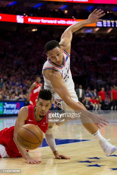 Ben Simmons of the Philadelphia 76ers and Danny Green of the Toronto Raptors fight for the ball in the second quarter of Game Six of the Eastern...