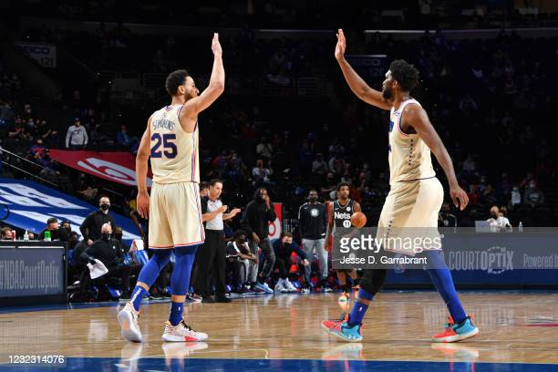 Ben Simmons of the Philadelphia 76ers and Joel Embiid of the Philadelphia 76ers high-five during a game against the Brooklyn Nets on April 14, 2021...