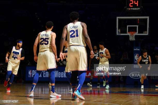 Ben Simmons of the Philadelphia 76ers and Joel Embiid of the Philadelphia 76ers look on during a game against the Brooklyn Nets on April 14, 2021 at...