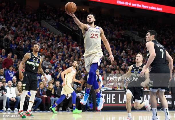 Ben Simmons of the Philadelphia 76ers attempts a layup as George Hill Pat Connaughton and Ersan Ilyasova of the Milwaukee Bucks look on during the...