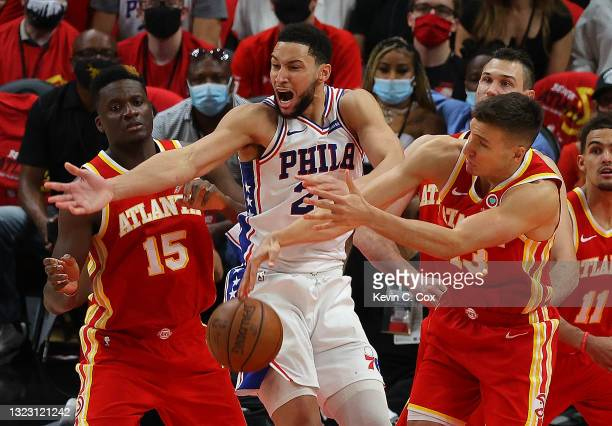 Ben Simmons of the Philadelphia 76ers battles for a rebound against Bogdan Bogdanovic of the Atlanta Hawks during the second half of game 3 of the...