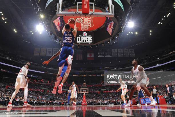 Ben Simmons of the Philadelphia 76ers catches an alleyopp for a dunk against the LA Clippers on November 13 2017 at STAPLES Center in Los Angeles...