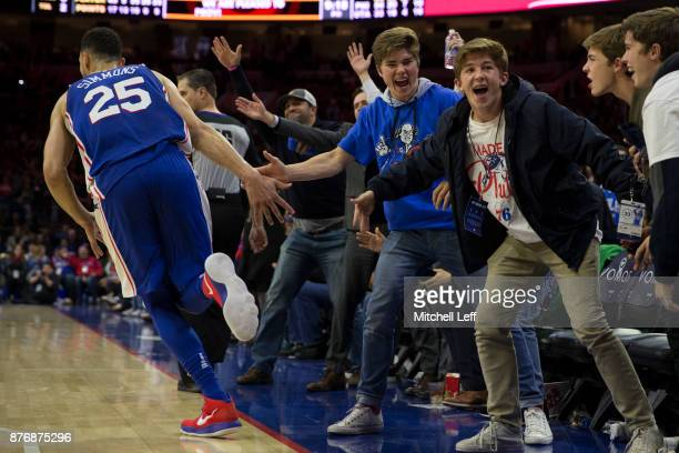 Ben Simmons of the Philadelphia 76ers celebrates with fans after making a basket against the Utah Jazz in the fourth quarter at the Wells Fargo...