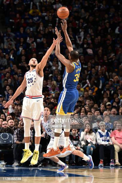 Ben Simmons of the Philadelphia 76ers contests the shot by Kevin Durant of the Golden State Warriors on March 2 2019 at the Wells Fargo Center in...