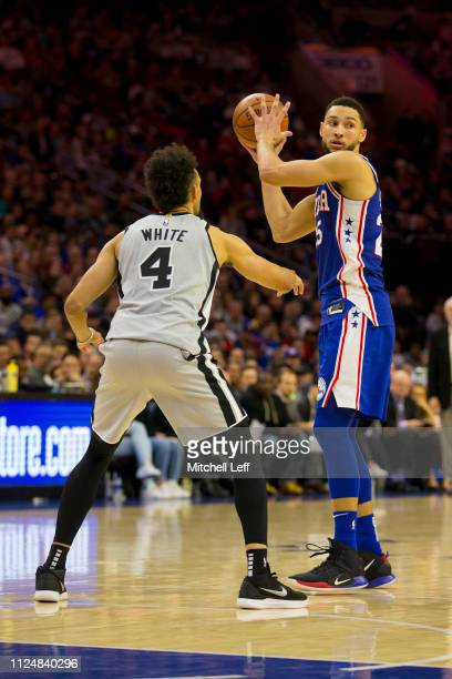 Ben Simmons of the Philadelphia 76ers controls the ball against Derrick White of the San Antonio Spurs at the Wells Fargo Center on January 23 2019...