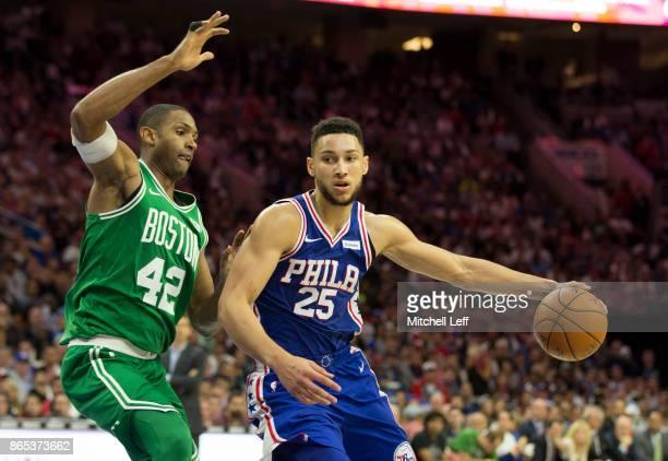 Ben Simmons of the Philadelphia 76ers dribbles the ball against Al Horford of the Boston Celtics at the Wells Fargo Center on October 20 2017 in...