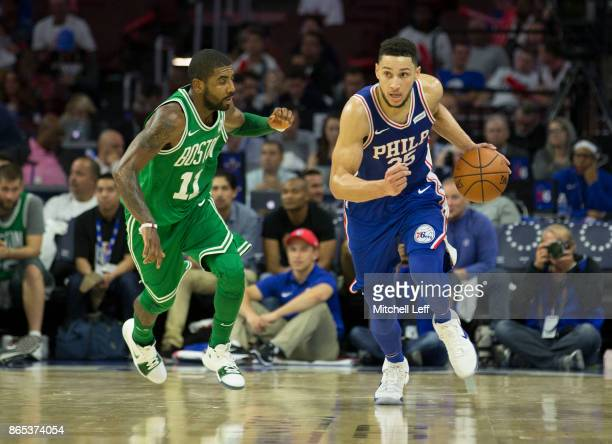 Ben Simmons of the Philadelphia 76ers dribbles the ball against Kyrie Irving of the Boston Celtics at the Wells Fargo Center on October 20 2017 in...