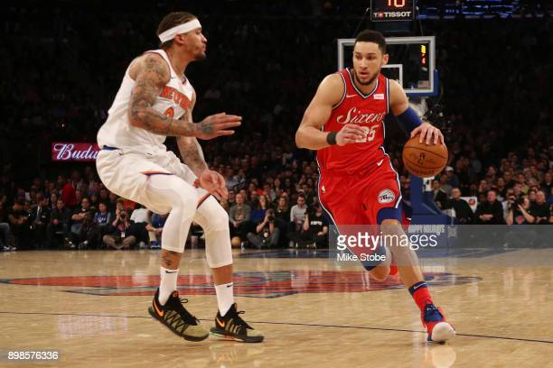 Ben Simmons of the Philadelphia 76ers dribbles the ball aganst Michael Beasley of the New York Knicks at Madison Square Garden on December 25 2017 in...