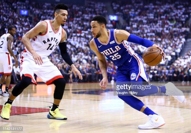 Ben Simmons of the Philadelphia 76ers dribbles the ball as Danny Green of the Toronto Raptors defends in the first half during Game Five of the...