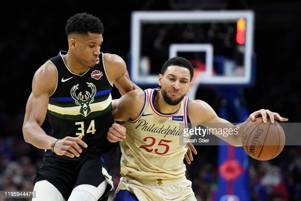 Ben Simmons of the Philadelphia 76ers dribbles the ball as Giannis Antetokounmpo of the Milwaukee Bucks defends during the second half of the game at...