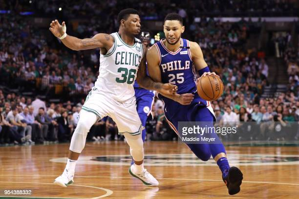 Ben Simmons of the Philadelphia 76ers drives against Marcus Smart of the Boston Celtics during the first quarter of Game Two of the Eastern...