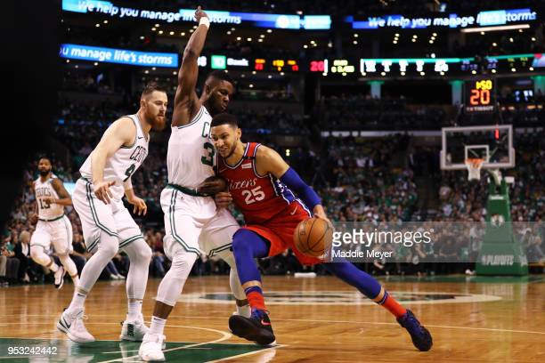 Ben Simmons of the Philadelphia 76ers drives against Semi Ojeleye of the Boston Celtics during the first quarter of Game One of Round Two of the 2018...