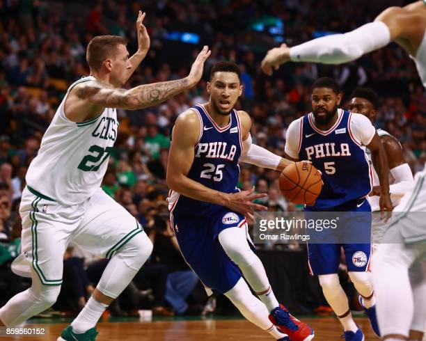 Ben Simmons of the Philadelphia 76ers drives on Daniel Theis of the Boston Celtics during the second half of the game at TD Garden on October 9 2017...