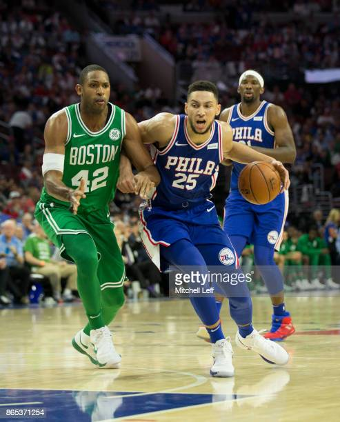 Ben Simmons of the Philadelphia 76ers drives to the basket against Al Horford of the Boston Celtics at the Wells Fargo Center on October 20 2017 in...