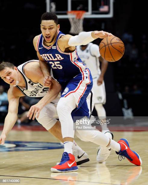 Ben Simmons of the Philadelphia 76ers drives with the ball past Timofey Mozgov of the Brooklyn Nets during a preseason NBA basketball game on October...