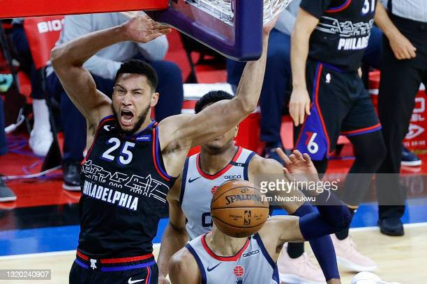 Ben Simmons of the Philadelphia 76ers dunks over Russell Westbrook of the Washington Wizards during Game Two of the Eastern Conference first round...