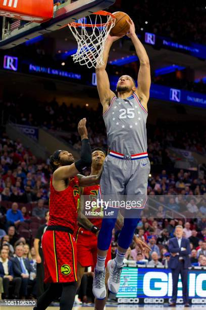 Ben Simmons of the Philadelphia 76ers dunks the ball against DeAndre' Bembry and John Collins of the Atlanta Hawks in the first quarter at the Wells...