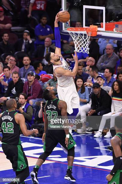 Ben Simmons of the Philadelphia 76ers dunks the ball against Semi Ojeleye of the Boston Celtics during Game Three of the Eastern Conference...