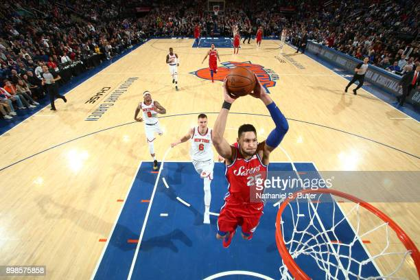 Ben Simmons of the Philadelphia 76ers dunks the ball against the New York Knicks on December 25 2017 at Madison Square Garden in New York City New...