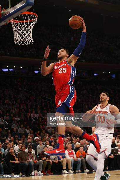 Ben Simmons of the Philadelphia 76ers dunks the ball against the New York Knicks at Madison Square Garden on December 25 2017 in New York City