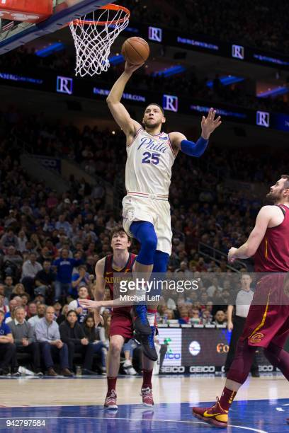 Ben Simmons of the Philadelphia 76ers dunks the ball past Cedi Osman of the Cleveland Cavaliers in the second quarter at the Wells Fargo Center on...