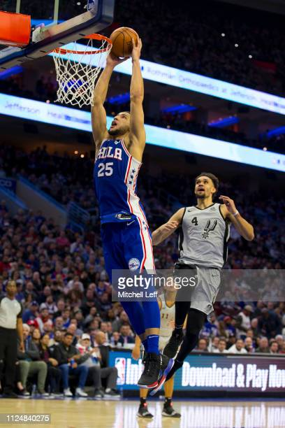 Ben Simmons of the Philadelphia 76ers dunks the ball past Derrick White of the San Antonio Spurs at the Wells Fargo Center on January 23 2019 in...