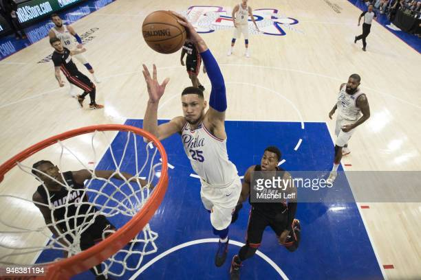 Ben Simmons of the Philadelphia 76ers dunks the ball past Josh Richardson and Hassan Whiteside of the Miami Heat in the first quarter during Game One...