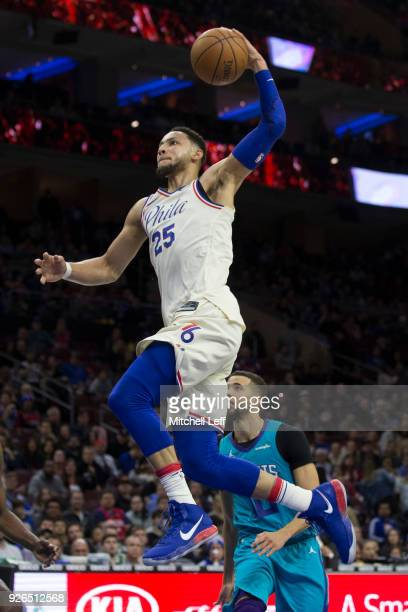 Ben Simmons of the Philadelphia 76ers dunks the ball past Michael CarterWilliams of the Charlotte Hornets in the second quarter at the Wells Fargo...