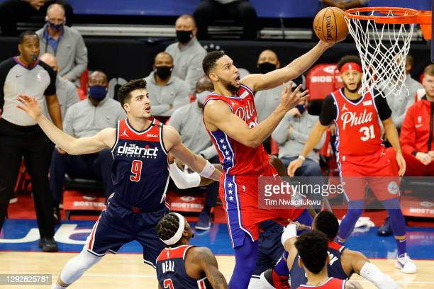 Ben Simmons of the Philadelphia 76ers elevates for a lay up during the third quarter against the Washington Wizards at Wells Fargo Center on December...