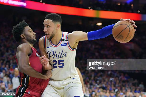 Ben Simmons of the Philadelphia 76ers fights off Justise Winslow of the Miami Heat at Wells Fargo Center on April 24 2018 in Philadelphia Pennsylvania