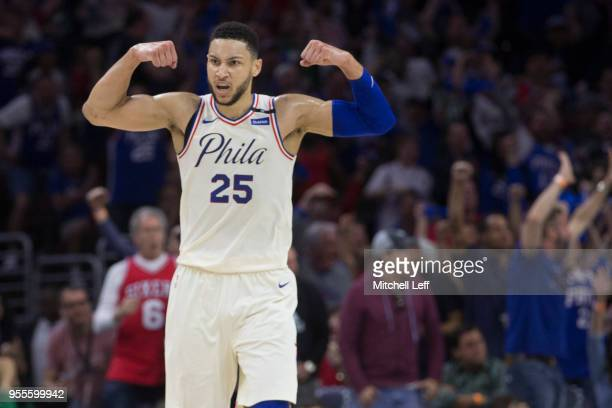 Ben Simmons of the Philadelphia 76ers flexes in reaction to a dunk by Joel Embiid against the Boston Celtics during Game Three of the Eastern...