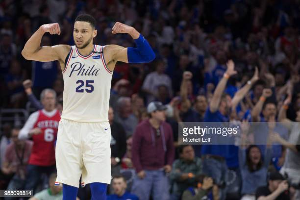 Ben Simmons of the Philadelphia 76ers flexes while the fans react to a dunk by Joel Embiid in the second quarter against the Boston Celtics during...