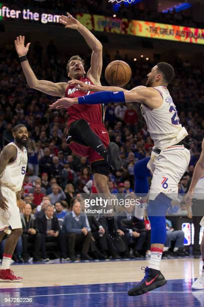 Ben Simmons of the Philadelphia 76ers fouls Goran Dragic of the Miami Heat in the third quarter during Game Two of the first round of the 2018 NBA...