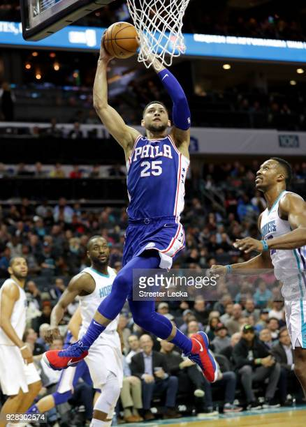 Ben Simmons of the Philadelphia 76ers goes to the basket against Dwight Howard of the Charlotte Hornets during their game at Spectrum Center on March...