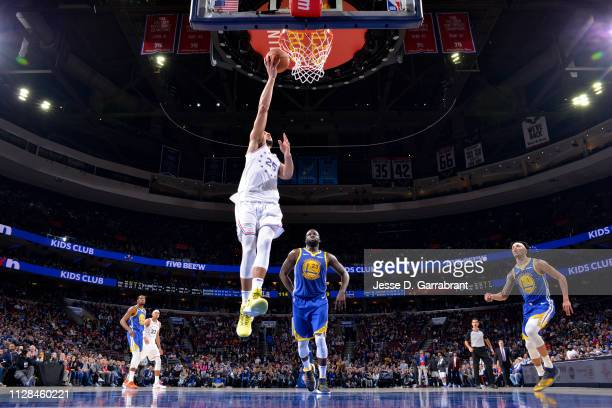 Ben Simmons of the Philadelphia 76ers goes to the basket against the Golden State Warriors on March 2 2019 at the Wells Fargo Center in Philadelphia...