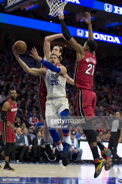 Ben Simmons of the Philadelphia 76ers goes up for a shot against Kelly Olynyk and Hassan Whiteside of the Miami Heat in the second quarter during...