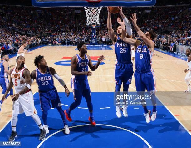 Ben Simmons of the Philadelphia 76ers grabs the rebound against the Cleveland Cavaliers at Wells Fargo Center on November 27 2017 in Philadelphia...