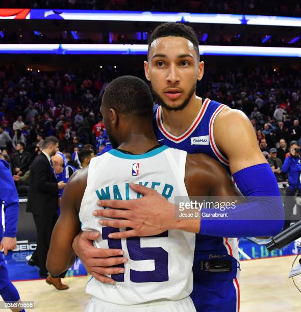 Ben Simmons of the Philadelphia 76ers greets Kemba Walker of the Charlotte Hornets after their win at the Wells Fargo Center on March 19 2018 in...