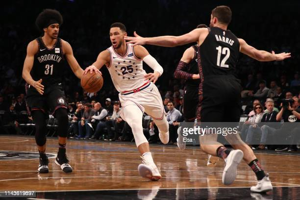 Ben Simmons of the Philadelphia 76ers handles the ball against Jarrett Allen and Joe Harris of the Brooklyn Nets in the third quarter during game...