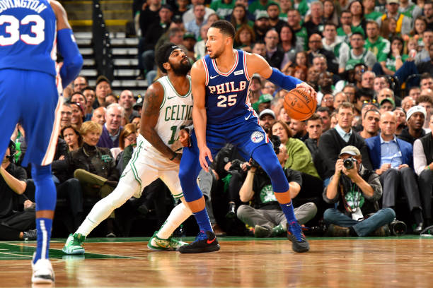 Ben Simmons of the Philadelphia 76ers handles the ball against Kyrie Irving of the Boston Celtics during a game on October 16 2018 at TD Garden in...