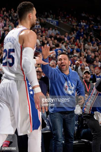 Ben Simmons of the Philadelphia 76ers high fives a fan during the game against the LA Clippers at Wells Fargo Center on February 10 2018 in...