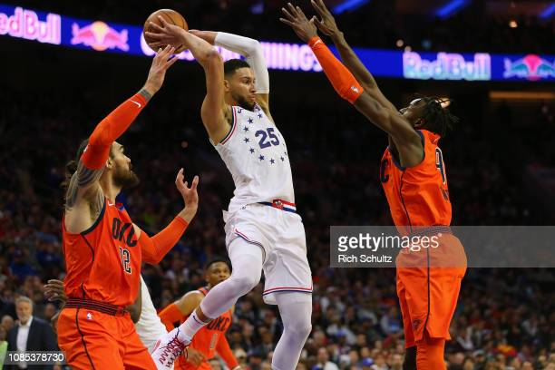 Ben Simmons of the Philadelphia 76ers looks to pass the ball as Steven Adams and Jerami Grant of the Oklahoma City Thunder defend during the first...